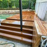 New timber deck over an in ground pool renovation projects in Merrylands by Passion Built finished outdoor living area