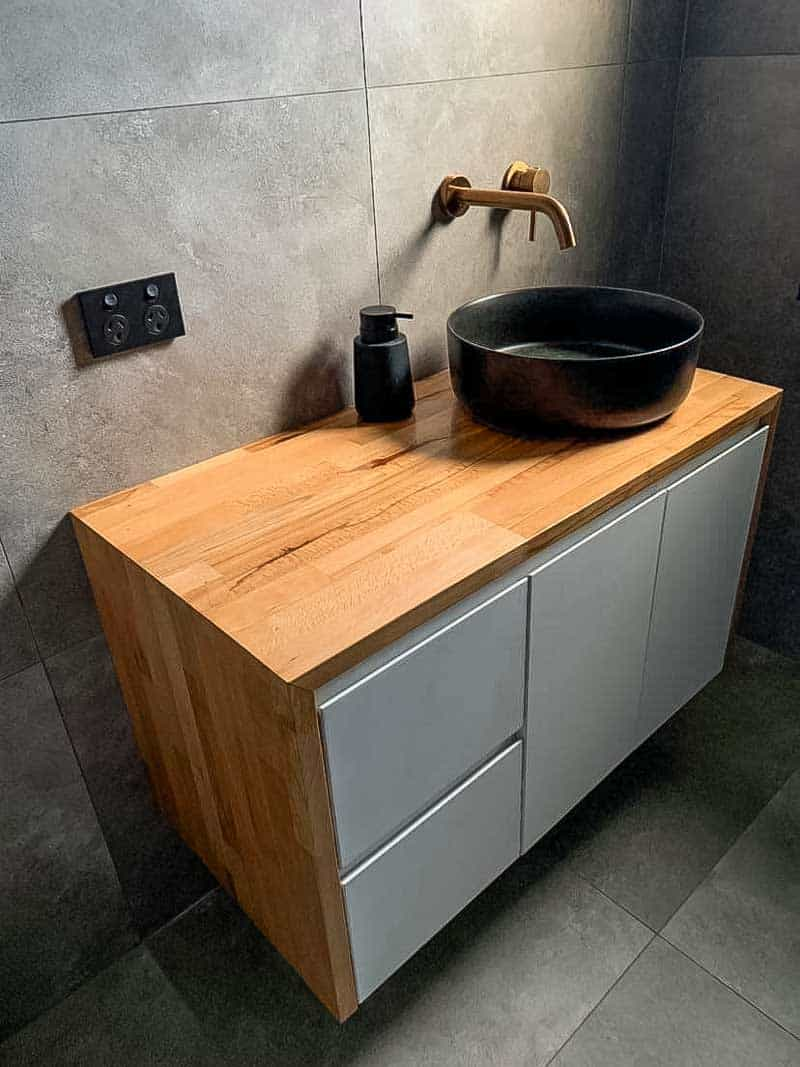 Small bathroom renovation with ABI Interiors tapware and floating timber vanity unit by a home renovation specialist using a licensed builder Dylan Doncevski from Passion Built in Merrylands