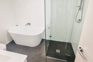 Renovating-a-World-Tower-Meriton-Unit-bathroom-with-bath-and-shower-in-Sydney